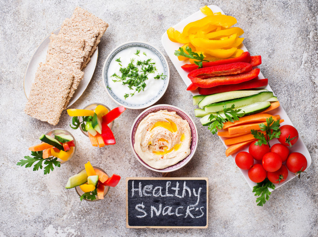 Snacks bar. Healthy vegetables sticks and hummus