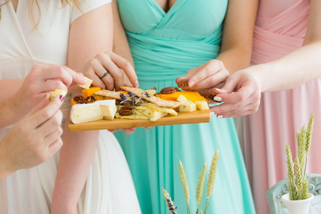 women eating cheese