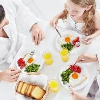 Family with a child has breakfast