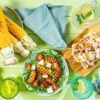 Summer bbq party concept - grilled chicken, vegetables, corn, salad, top view, copy space