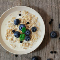 Overnight Oats with banana and blueberries overhead view / Healthy breakfast